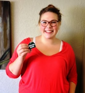 Salem Green Apartments resident displaying keys to her new home