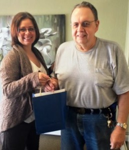 Salem Green Manager giving gift bag to new resident.