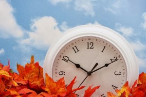 Picture of clock and leaves.