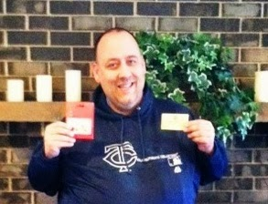Picture of Joe holding two gift cards.