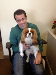 photo of man holding a medium-sized dog.