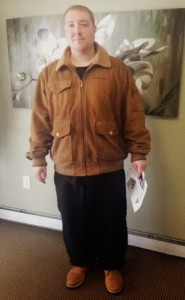Photo of Joel in a brown coat in the Salem Green Apartments office