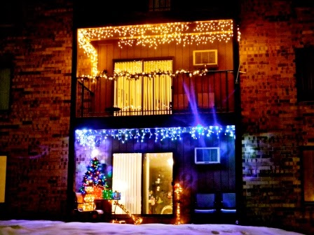 Photo of patio and balcony decorated with holiday lights.