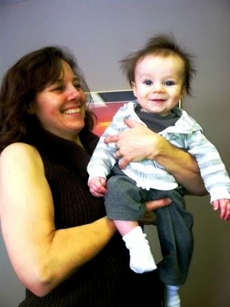 Karla holding her grandson, Carson