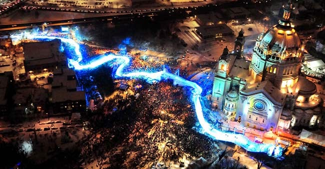 Crashed ice course lit up, as it weaves past the cathedral and downhill to downtown St. Paul.
