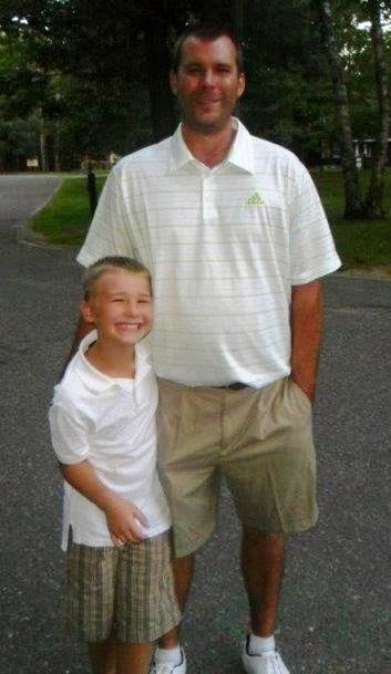 Photo of steve and alex posing for the camera during a golf outing.