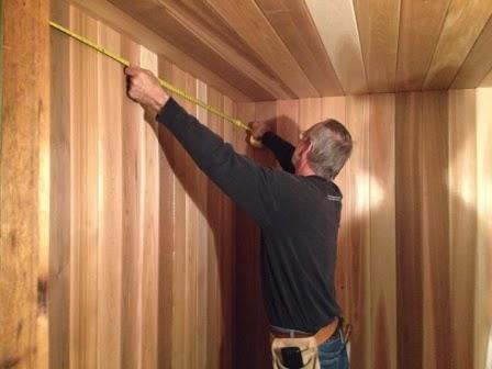 Robert measuring the space inside the men's sauna.