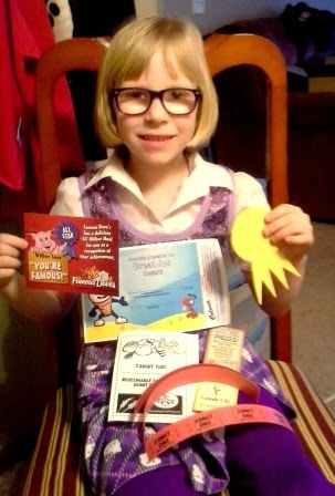 Kayla showing her prizes from winning a raffle sales contest.
